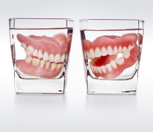 dentures soaking in glass